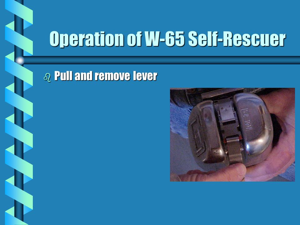 Operation of W-65 Self-Rescuer b Open self-rescuer by firmly pulling lever up to break canister seal