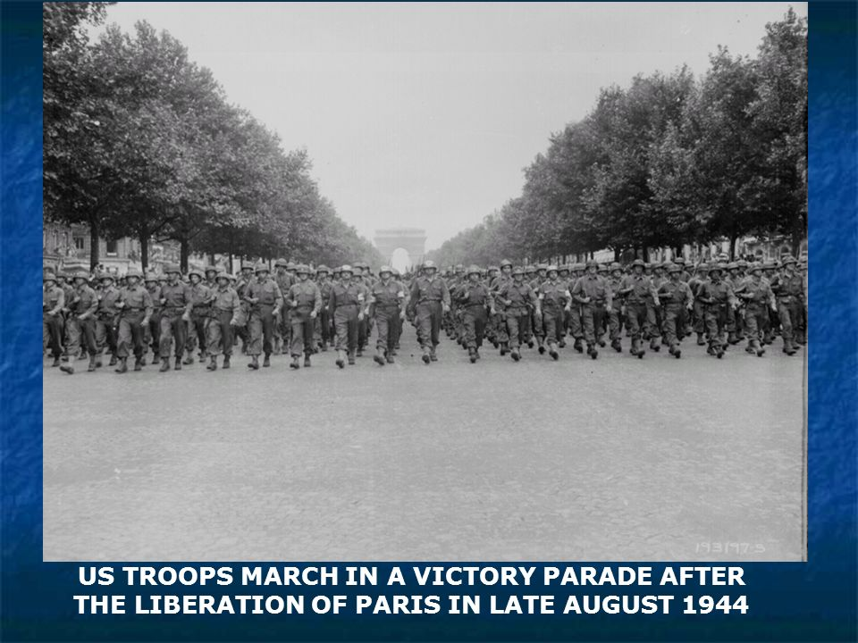 US TROOPS MARCH IN A VICTORY PARADE AFTER THE LIBERATION OF PARIS IN LATE AUGUST 1944