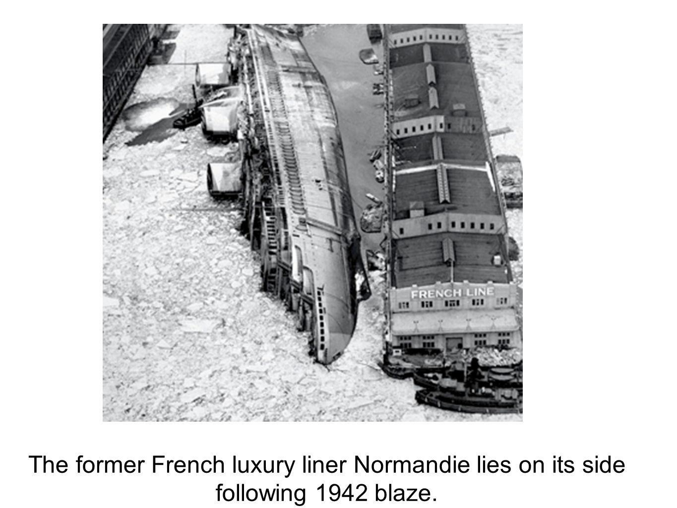 The former French luxury liner Normandie lies on its side following 1942 blaze.
