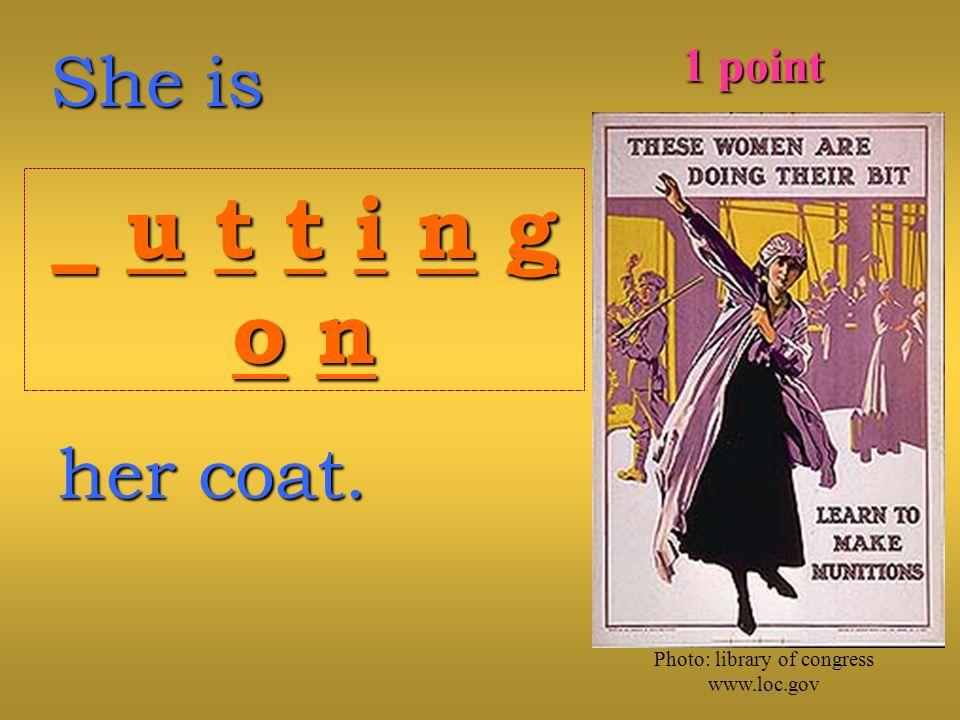 She is _ u t t i n g_ u t t i n go no n_ u t t i n g_ u t t i n go no n her coat.