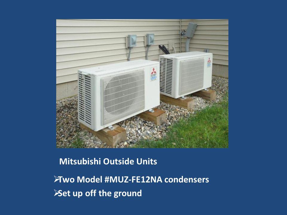 Mitsubishi Outside Units Two Model #MUZ-FE12NA condensers Set up off the ground