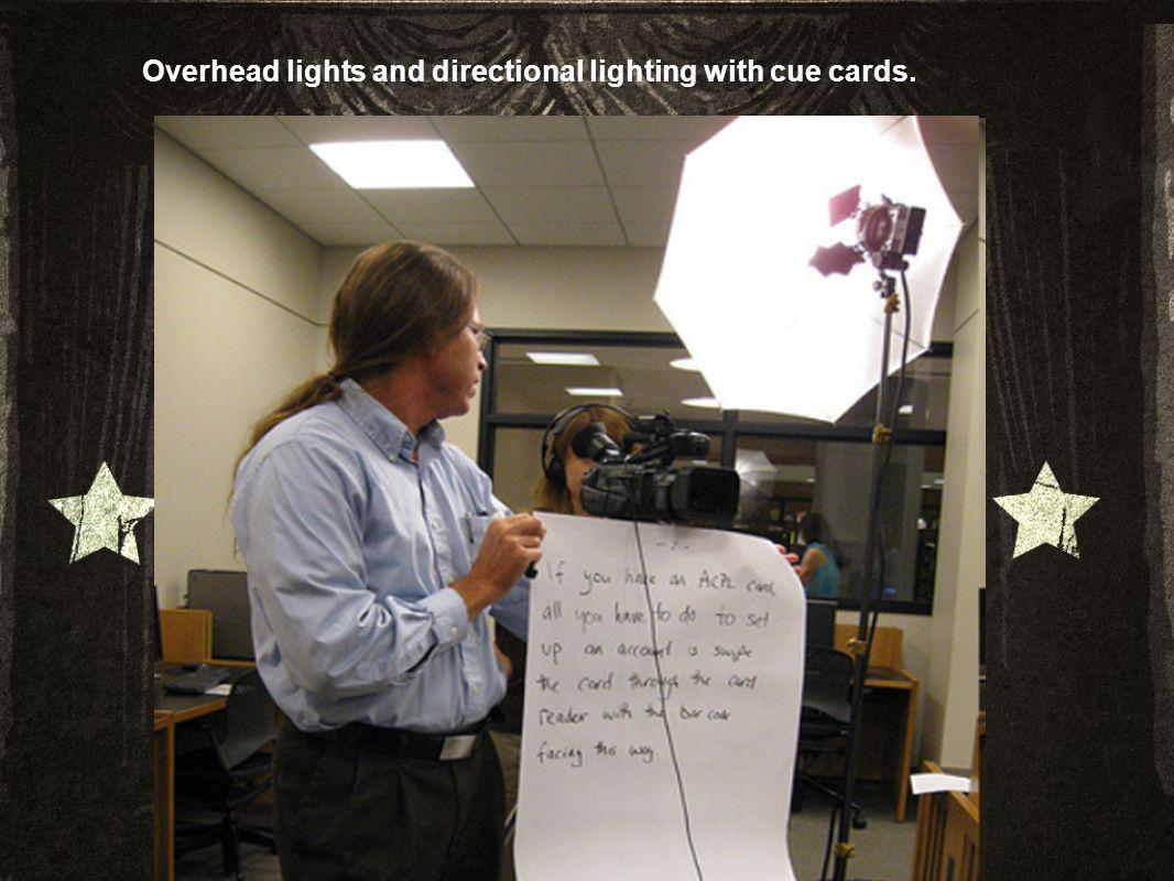 Overhead lights and directional lighting with cue cards.