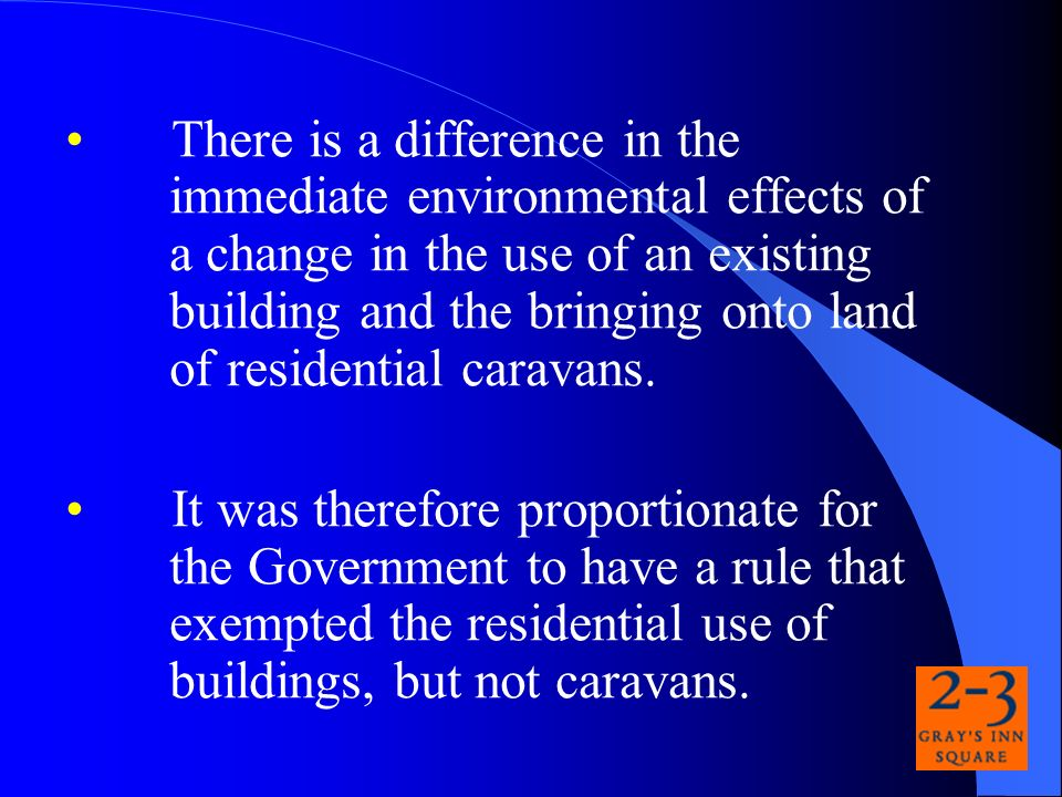 There is a difference in the immediate environmental effects of a change in the use of an existing building and the bringing onto land of residential caravans.