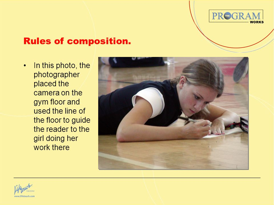 Rules of composition. In this photo, the photographer placed the camera on the gym floor and used the line of the floor to guide the reader to the gir
