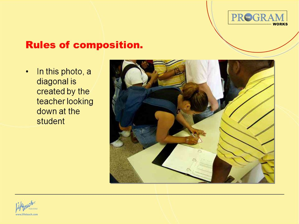 Rules of composition. In this photo, a diagonal is created by the teacher looking down at the student