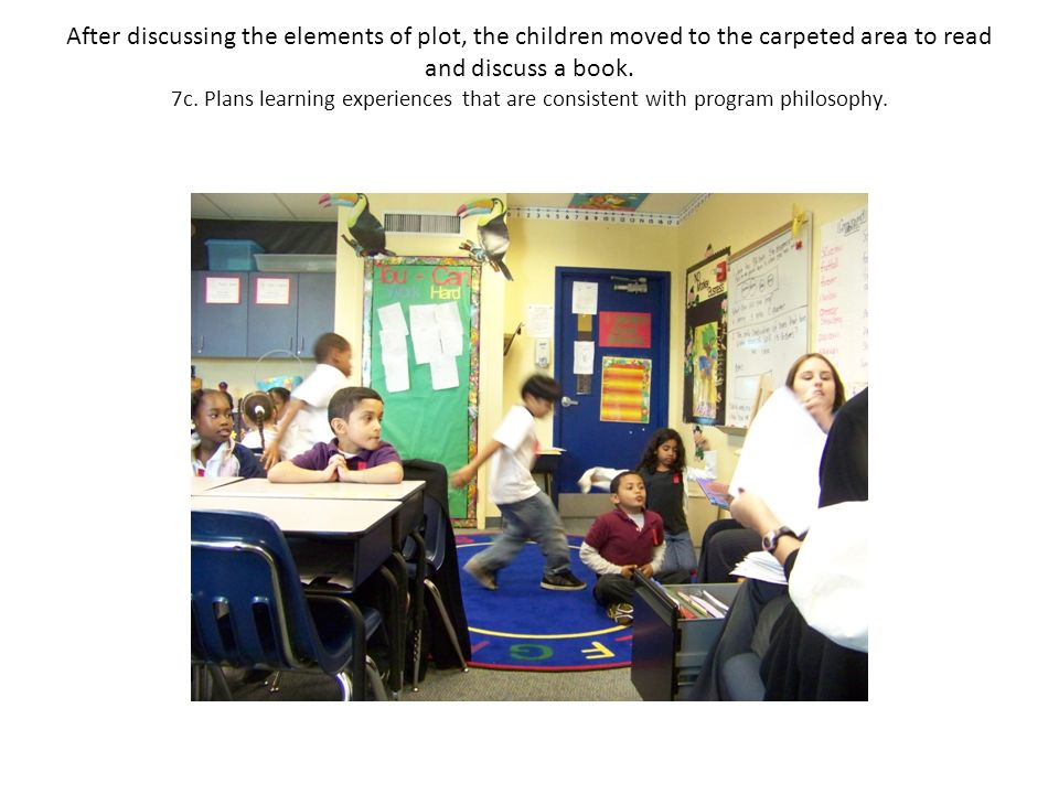 After discussing the elements of plot, the children moved to the carpeted area to read and discuss a book.