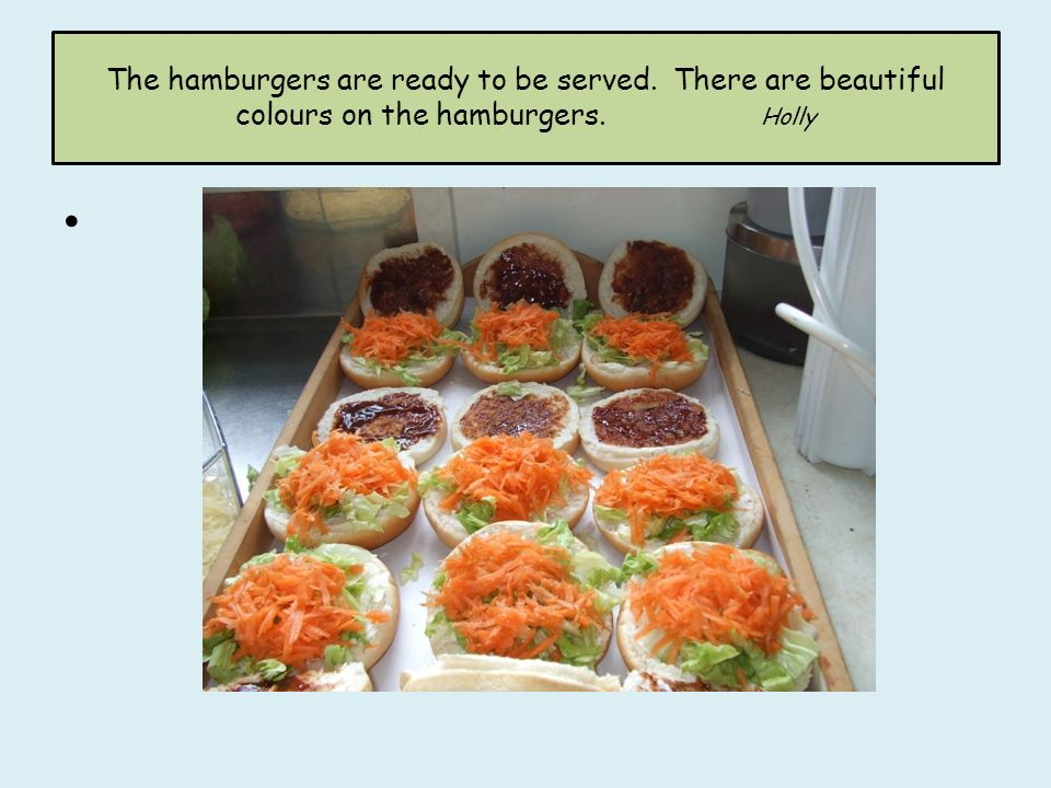 The hamburgers are ready to be served. There are beautiful colours on the hamburgers. Holly