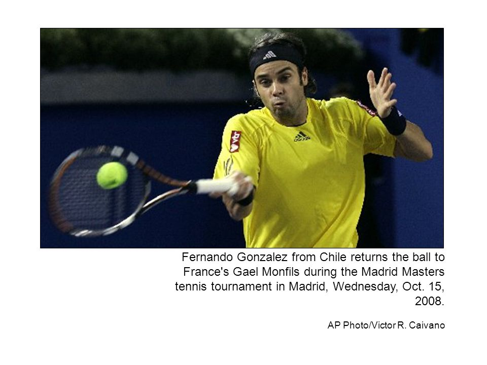 Fernando Gonzalez from Chile returns the ball to France's Gael Monfils during the Madrid Masters tennis tournament in Madrid, Wednesday, Oct. 15, 2008