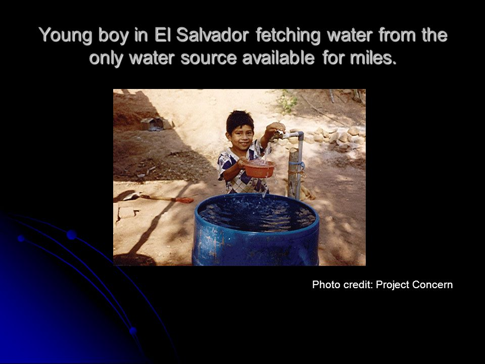 Young boy in El Salvador fetching water from the only water source available for miles. Photo credit: Project Concern