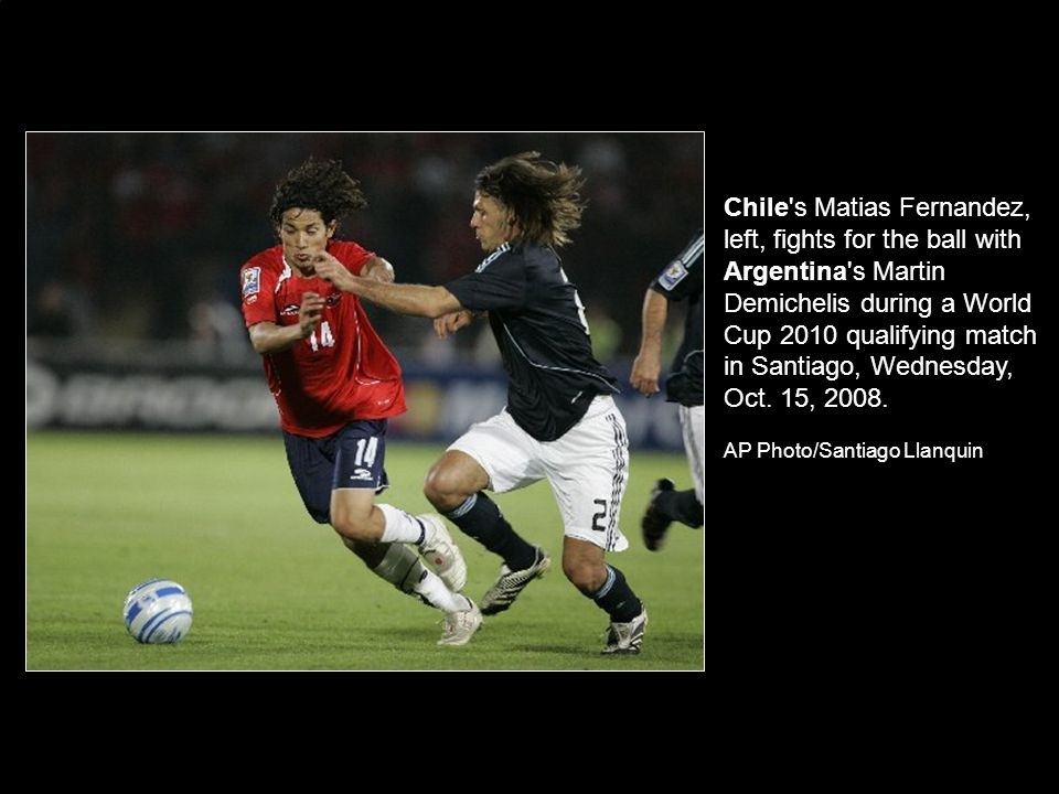 Chile s Matias Fernandez, left, fights for the ball with Argentina s Martin Demichelis during a World Cup 2010 qualifying match in Santiago, Wednesday, Oct.