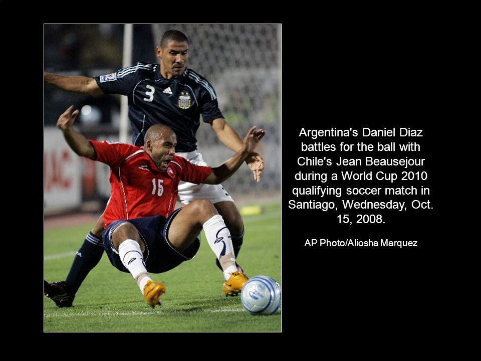 Argentina s Daniel Diaz battles for the ball with Chile s Jean Beausejour during a World Cup 2010 qualifying soccer match in Santiago, Wednesday, Oct.