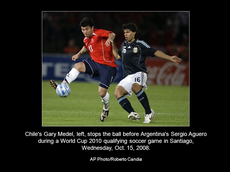Chile s Gary Medel, left, stops the ball before Argentina s Sergio Aguero during a World Cup 2010 qualifying soccer game in Santiago, Wednesday, Oct.