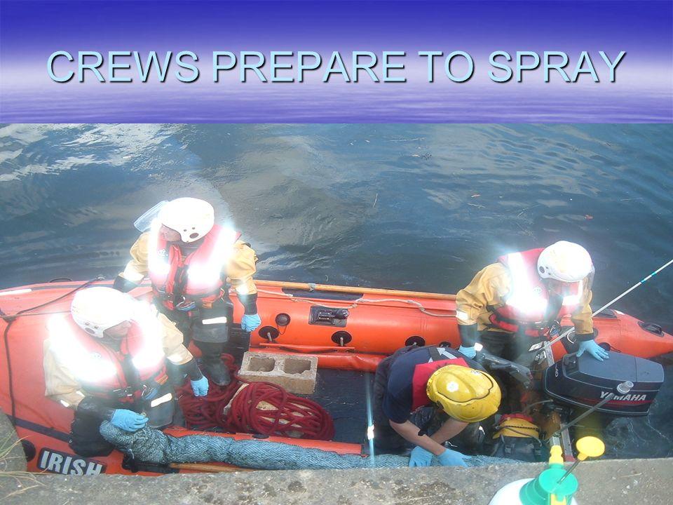 CREWS PREPARE TO SPRAY