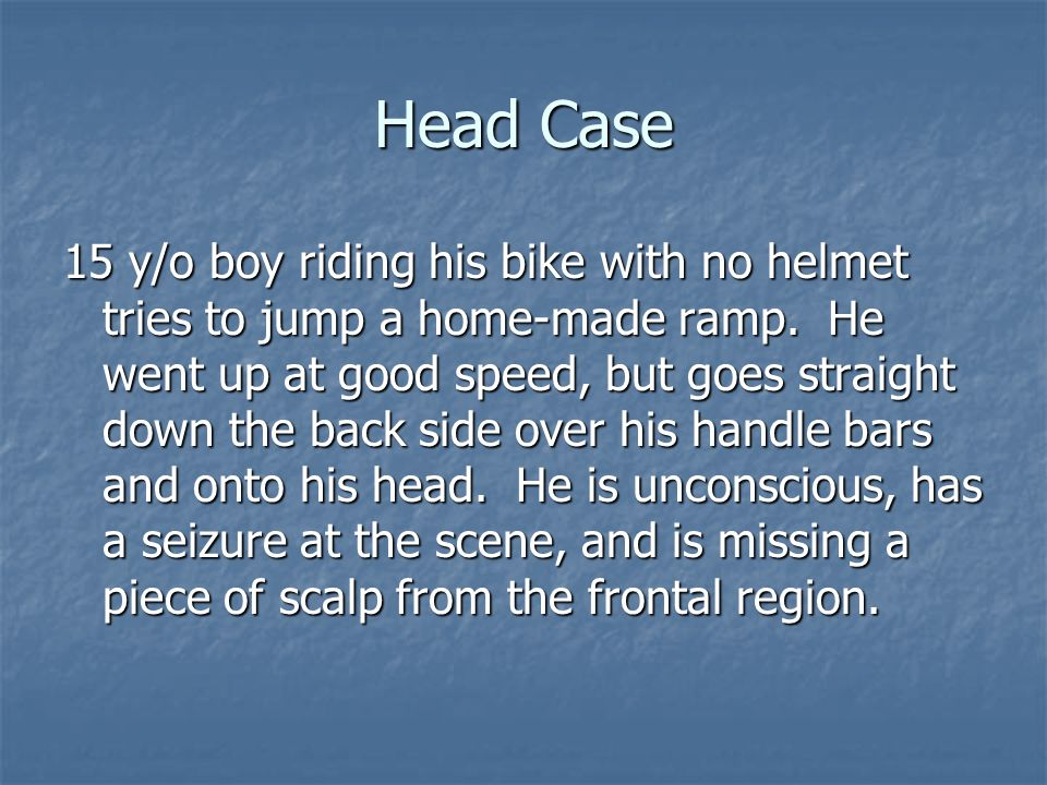 Head Case 15 y/o boy riding his bike with no helmet tries to jump a home-made ramp. He went up at good speed, but goes straight down the back side ove