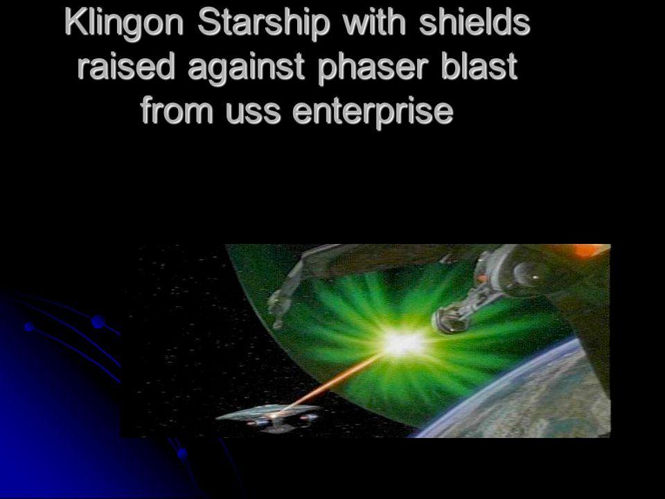 Klingon Starship with shields raised against phaser blast from uss enterprise