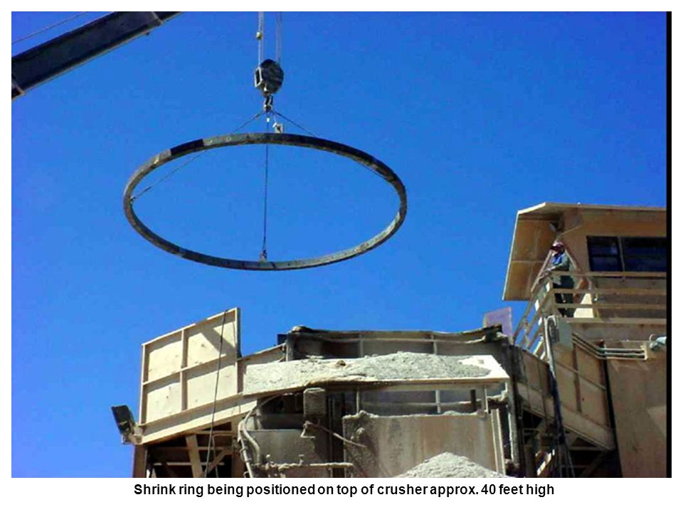 Shrink ring being positioned on top of crusher approx. 40 feet high