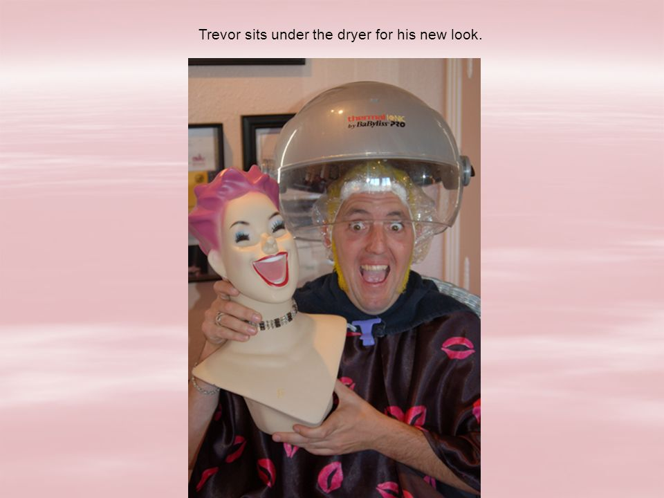 Trevor sits under the dryer for his new look.