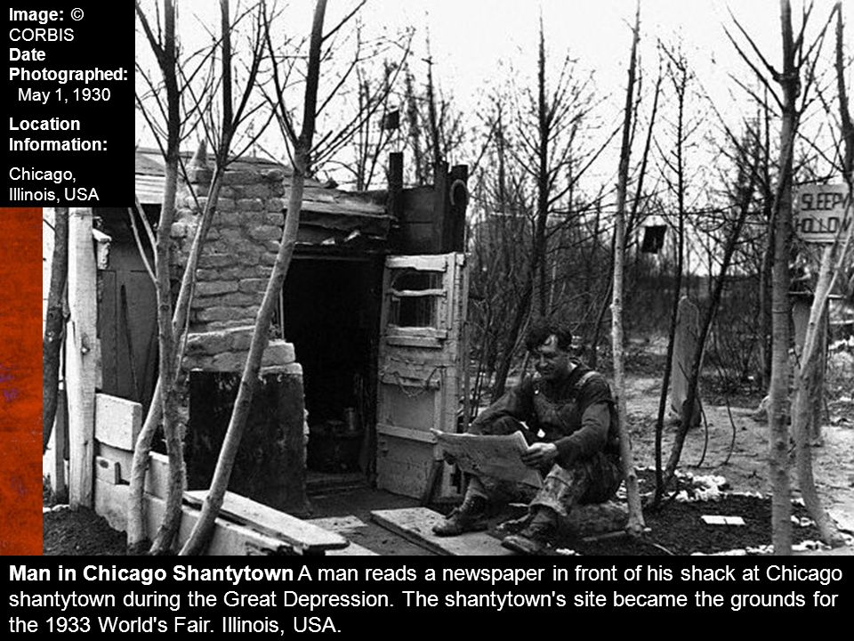Man in Chicago Shantytown A man reads a newspaper in front of his shack at Chicago shantytown during the Great Depression. The shantytown's site becam