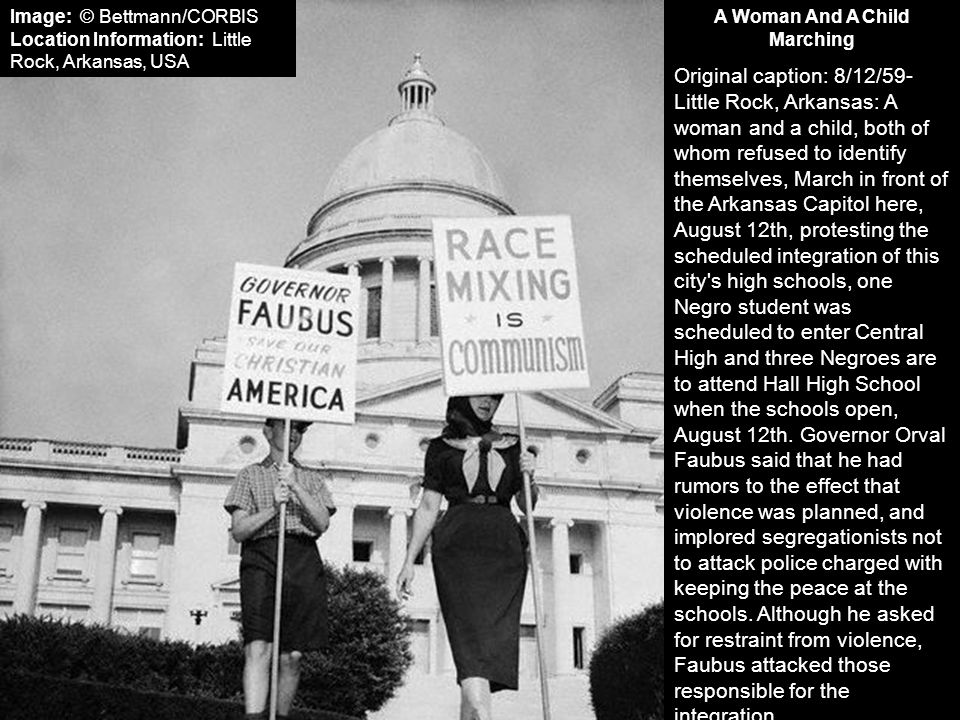 A Woman And A Child Marching Original caption: 8/12/59- Little Rock, Arkansas: A woman and a child, both of whom refused to identify themselves, March