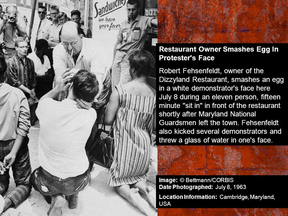 Restaurant Owner Smashes Egg In Protester's Face Robert Fehsenfeldt, owner of the Dizzyland Restaurant, smashes an egg in a white demonstrator's face