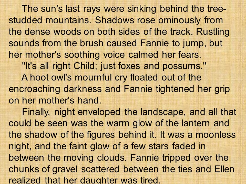 The sun's last rays were sinking behind the tree- studded mountains. Shadows rose ominously from the dense woods on both sides of the track. Rustling