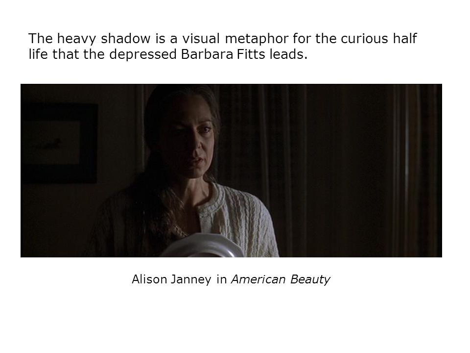 Alison Janney in American Beauty The heavy shadow is a visual metaphor for the curious half life that the depressed Barbara Fitts leads.