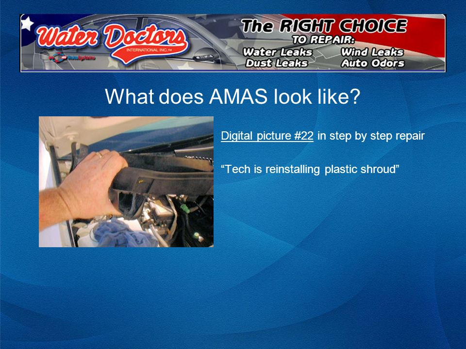 What does AMAS look like? Digital picture #22 in step by step repair Tech is reinstalling plastic shroud