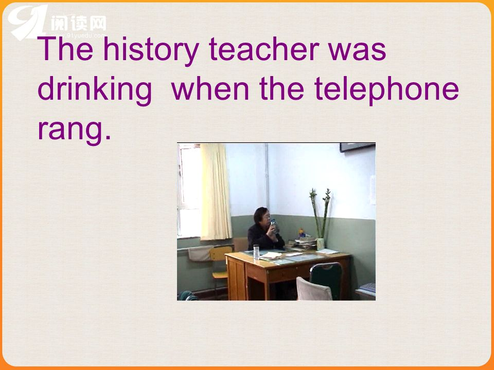 The history teacher was drinking when the telephone rang.