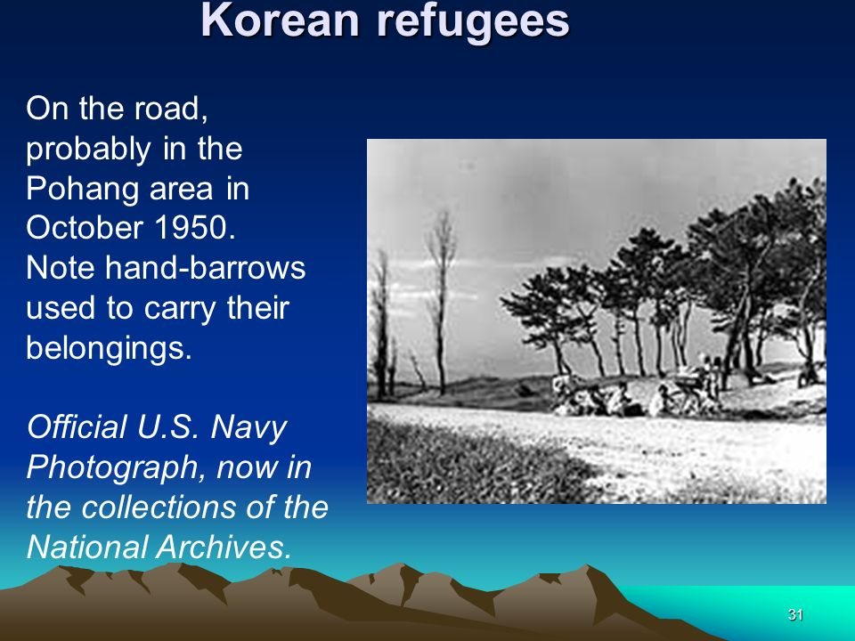 31 Korean refugees On the road, probably in the Pohang area in October 1950. Note hand-barrows used to carry their belongings. Official U.S. Navy Phot