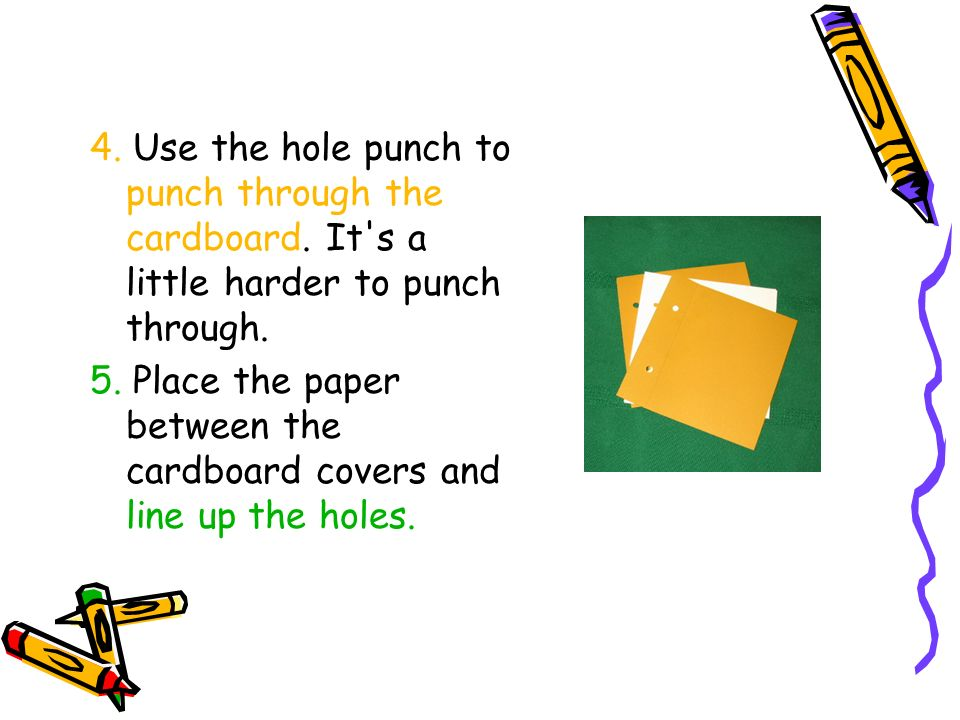 4. Use the hole punch to punch through the cardboard.