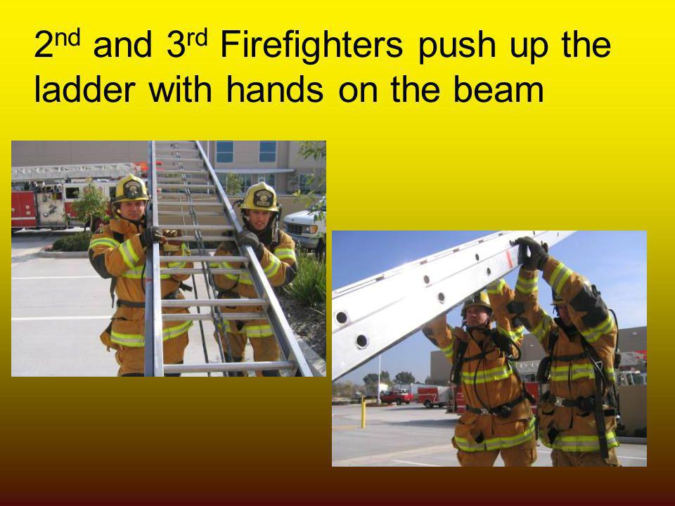 2 nd and 3 rd Firefighters push up the ladder with hands on the beam