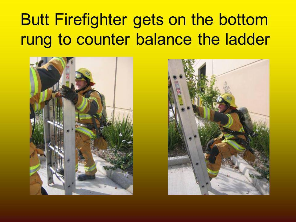 Butt Firefighter gets on the bottom rung to counter balance the ladder