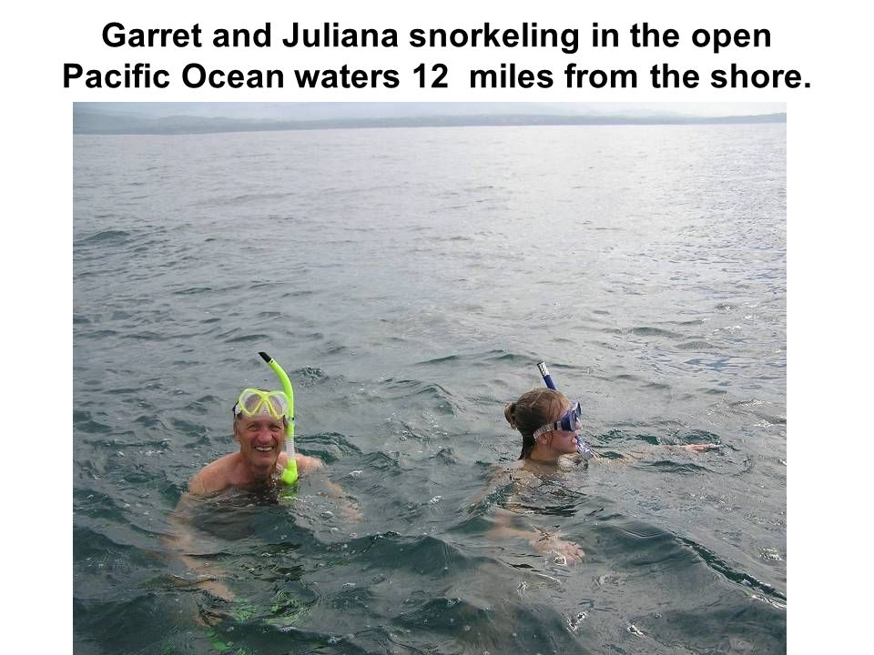 Garret and Juliana snorkeling in the open Pacific Ocean waters 12 miles from the shore.