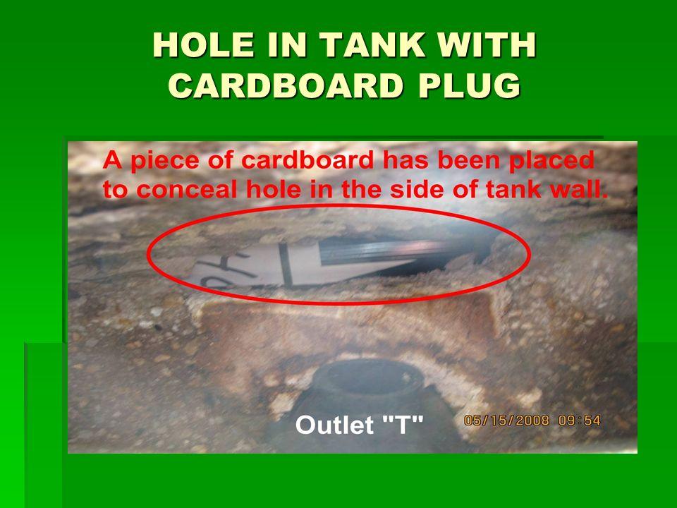 HOLE IN TANK WITH CARDBOARD PLUG