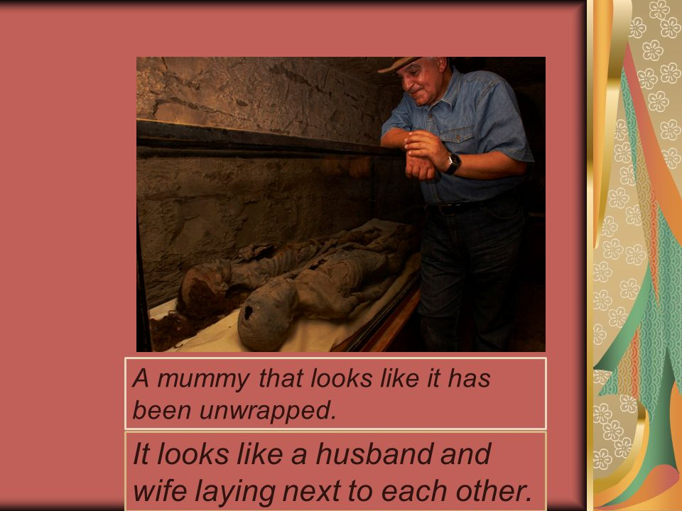 A mummy that looks like it has been unwrapped. It looks like a husband and wife laying next to each other.