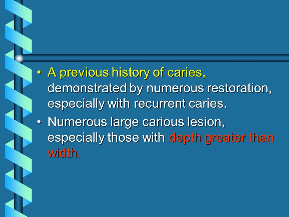 A previous history of caries, demonstrated by numerous restoration, especially with recurrent caries.A previous history of caries, demonstrated by num