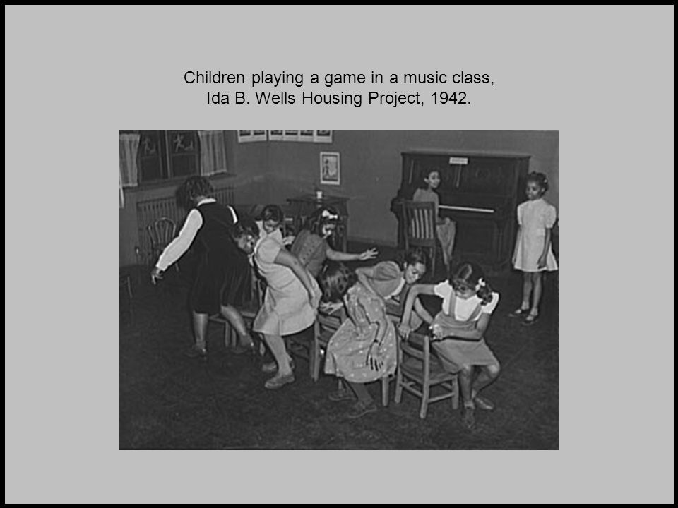 Children playing a game in a music class, Ida B. Wells Housing Project, 1942.
