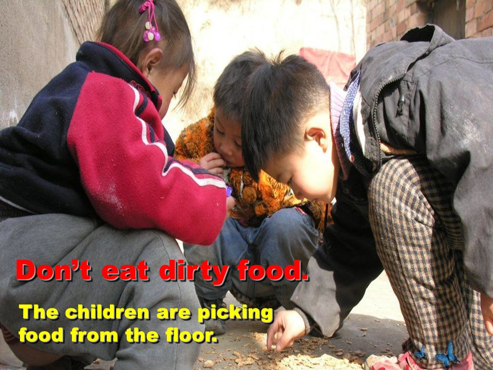 The children are picking food from the floor. Dont eat dirty food.