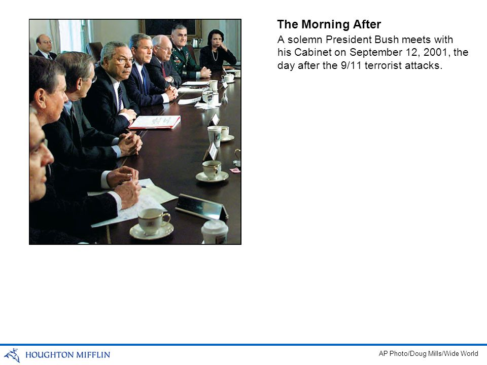 The Morning After A solemn President Bush meets with his Cabinet on September 12, 2001, the day after the 9/11 terrorist attacks. AP Photo/Doug Mills/