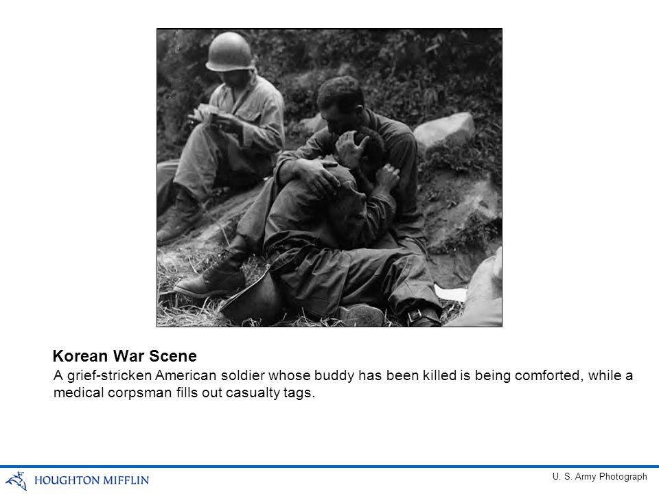 A grief-stricken American soldier whose buddy has been killed is being comforted, while a medical corpsman fills out casualty tags. Korean War Scene U