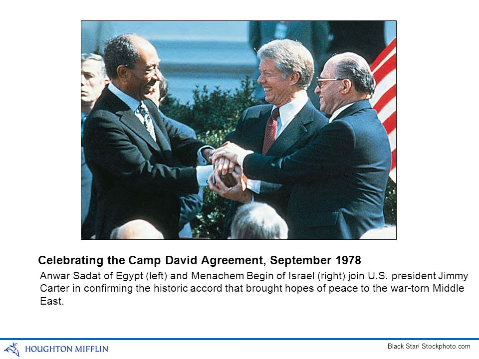 Anwar Sadat of Egypt (left) and Menachem Begin of Israel (right) join U.S. president Jimmy Carter in confirming the historic accord that brought hopes