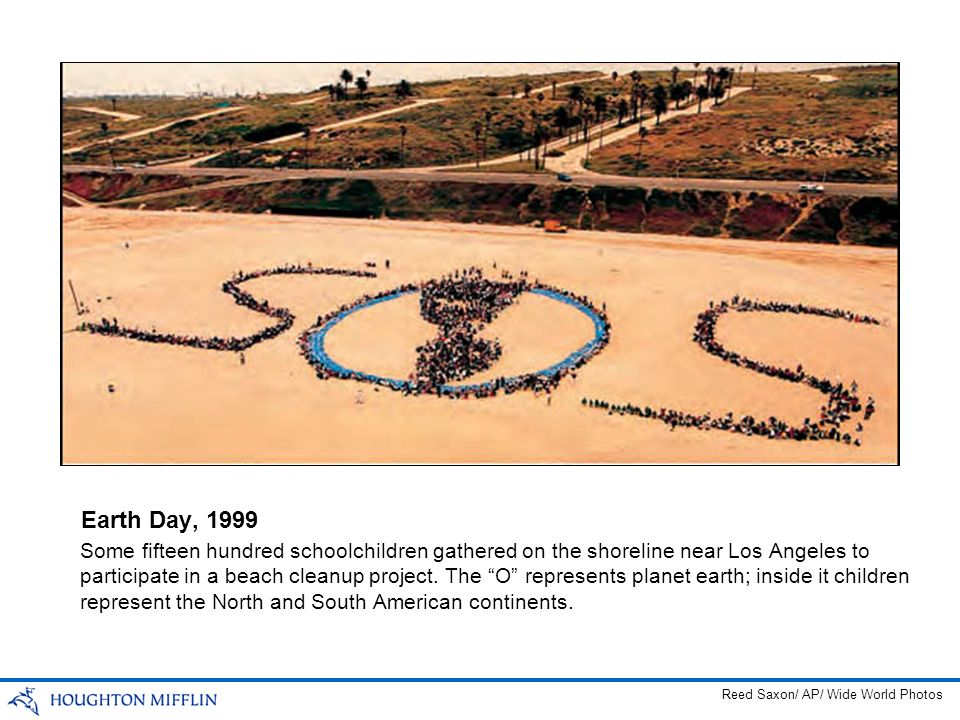 Some fifteen hundred schoolchildren gathered on the shoreline near Los Angeles to participate in a beach cleanup project. The O represents planet eart