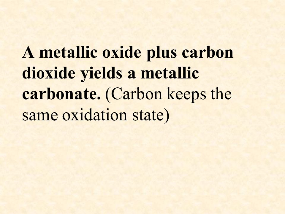 A metallic oxide plus carbon dioxide yields a metallic carbonate. (Carbon keeps the same oxidation state)