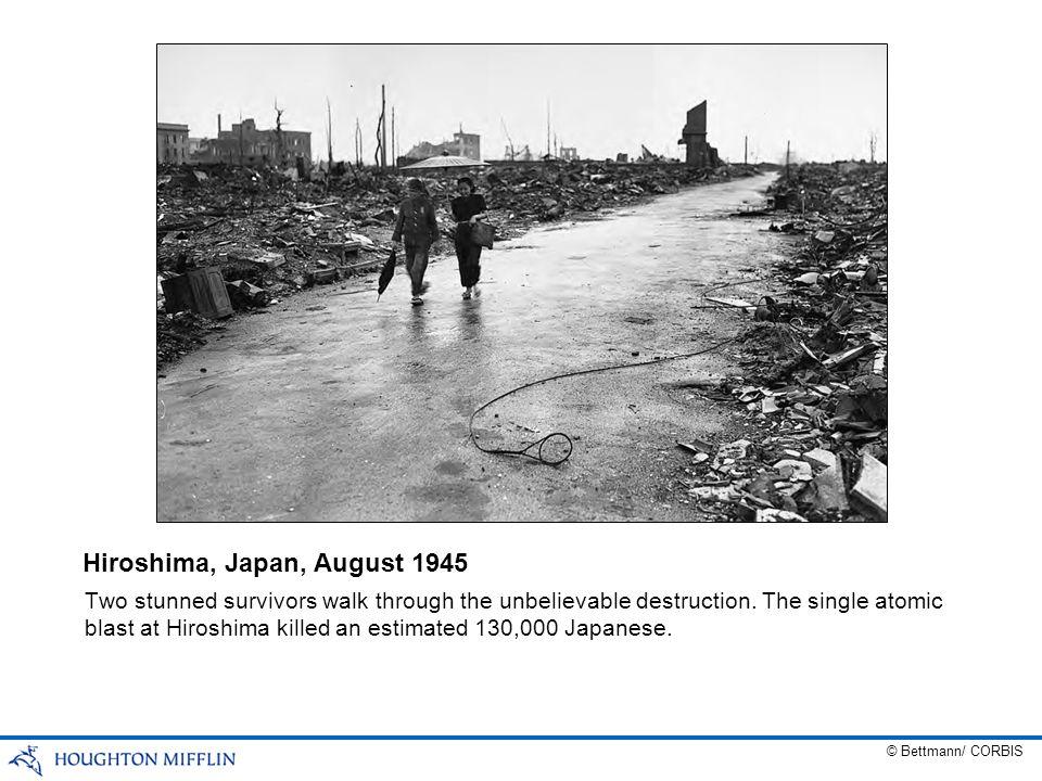 Two stunned survivors walk through the unbelievable destruction. The single atomic blast at Hiroshima killed an estimated 130,000 Japanese. Hiroshima,