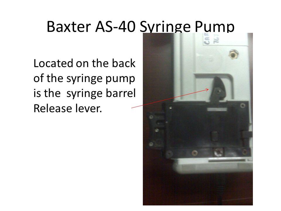 Baxter AS-40 Syringe Pump Syringe Barrel Clamp Release Lever (Back of pump.) When Depressed Barrel clamp will elevate.