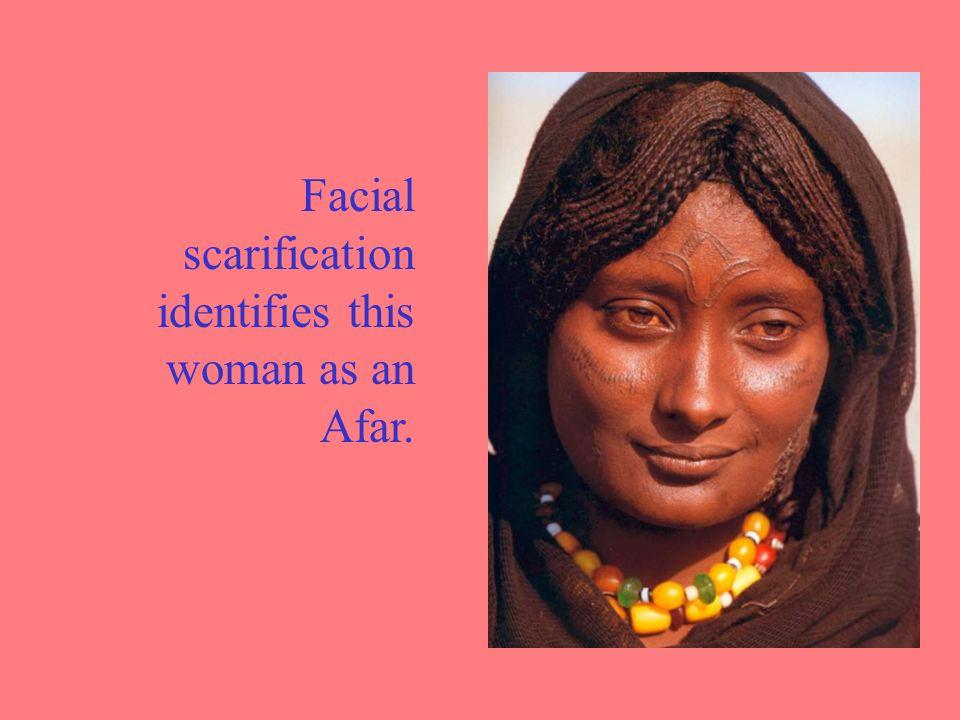 Facial scarification identifies this woman as an Afar.