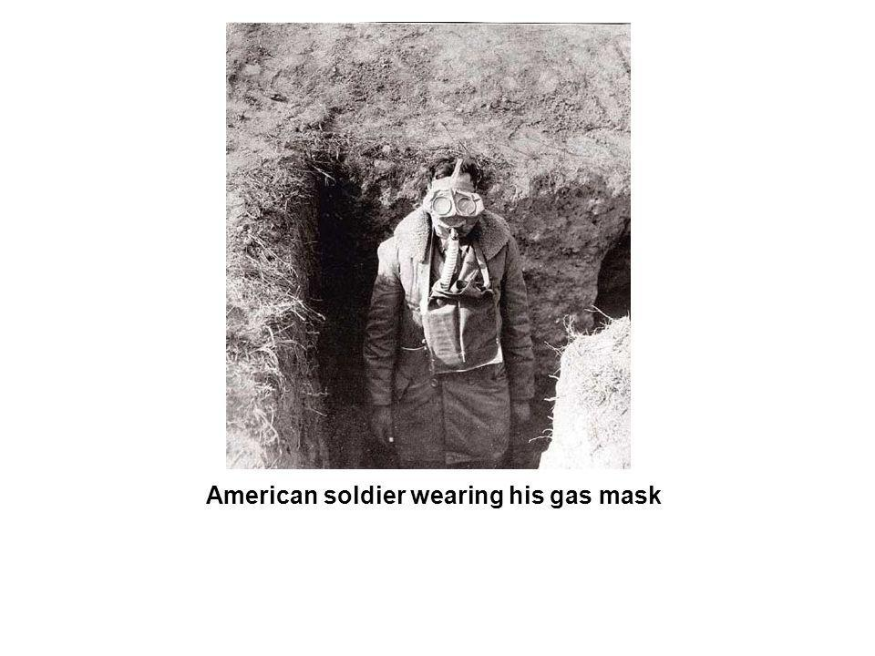 American soldier wearing his gas mask