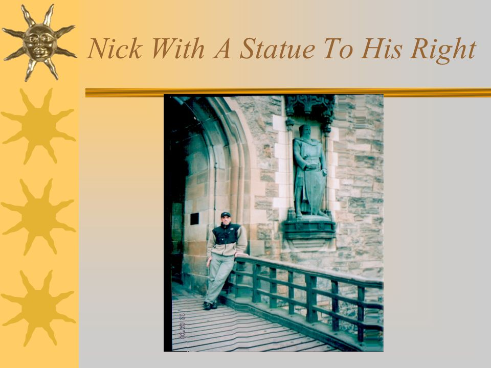 Nick With A Statue To His Right