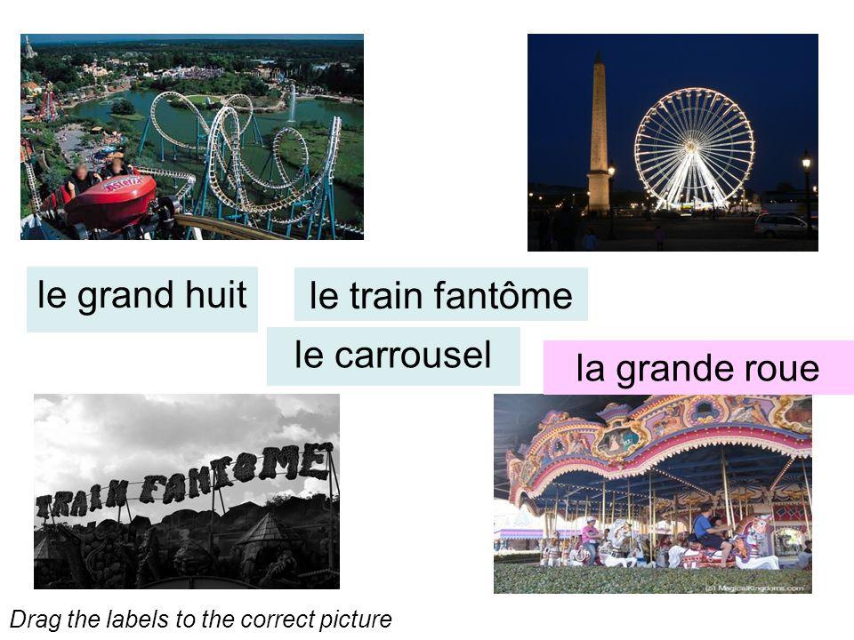 le train fantôme le grand huit le carrousel la grande roue Drag the labels to the correct picture