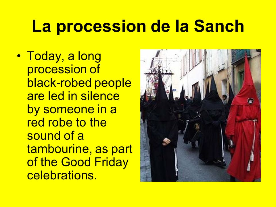 La procession de la Sanch Today, a long procession of black-robed people are led in silence by someone in a red robe to the sound of a tambourine, as